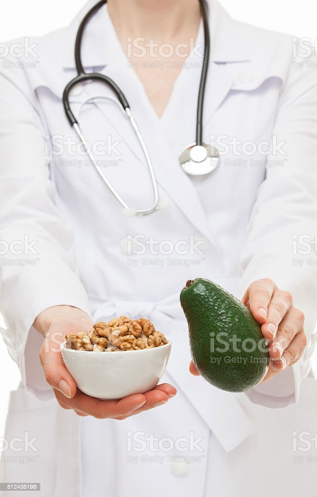 Dietitian proposing avocado and circassian walnut stock photo