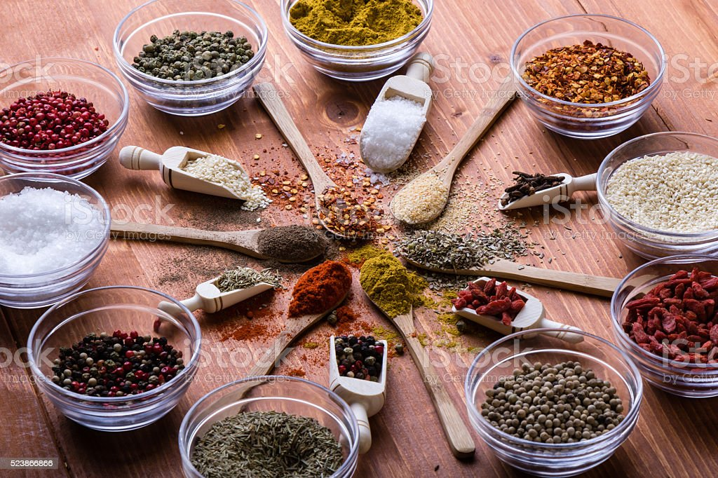 diferent color spices on wooden table stock photo
