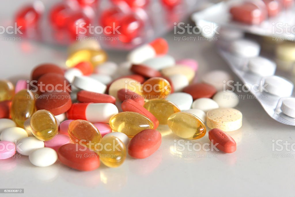 diferent Tablets pills capsule heap mix therapy drugs doctor flu stock photo