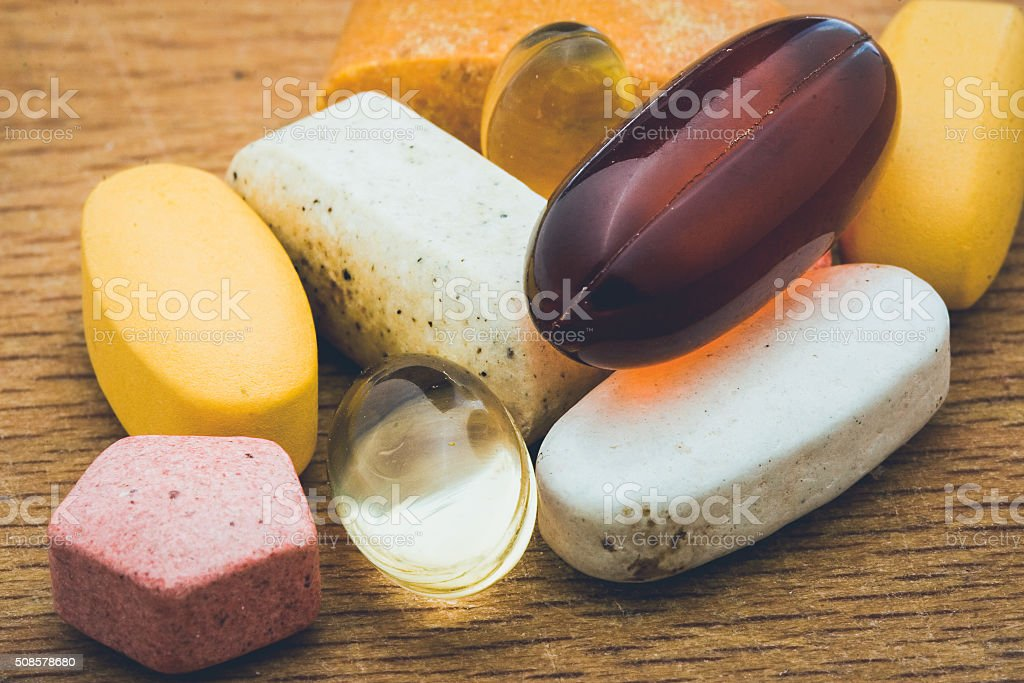 Diferrent kind of drugs on a wodden board stock photo