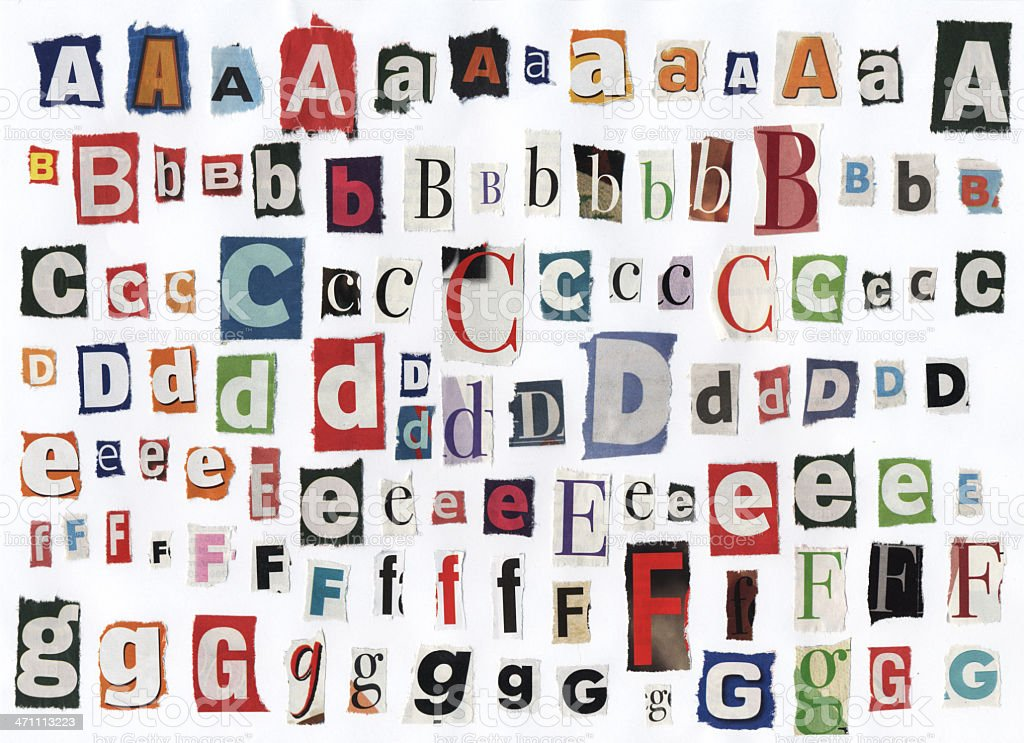 Different alphabet letters cut out of newspaper stock photo