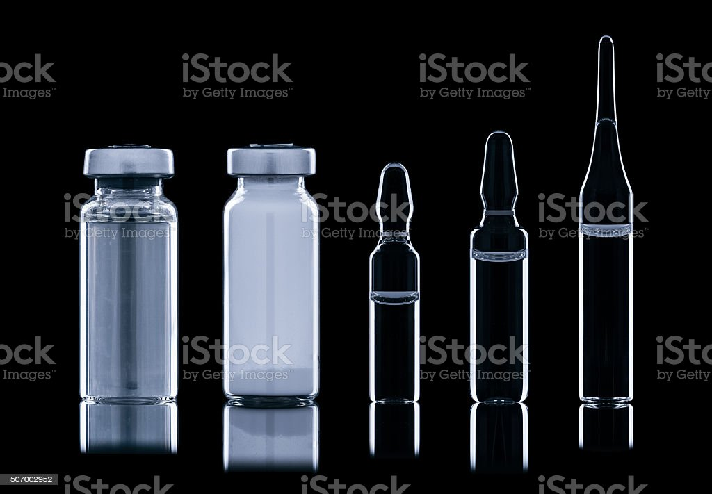 Different ampoule with liquid. stock photo