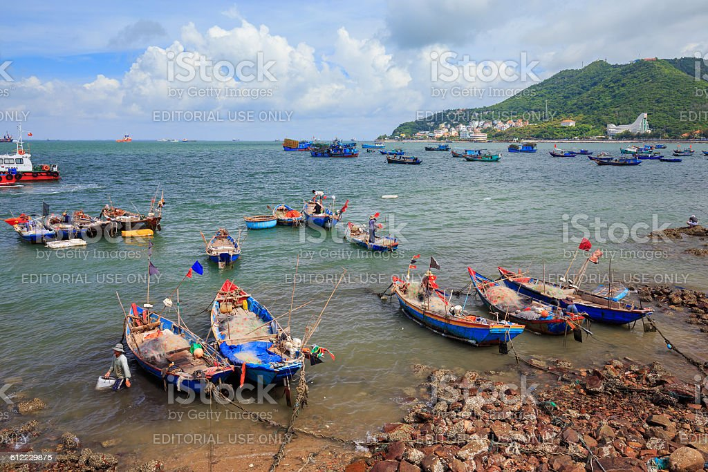 Different and colorful fishing boats in Vung Tau. stock photo