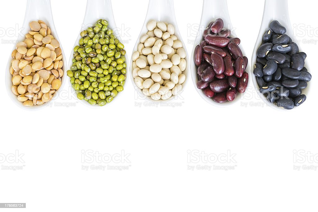 Different beans in white spoon royalty-free stock photo