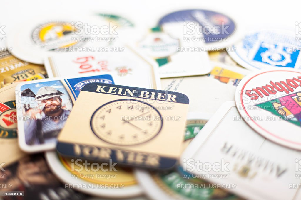 Different beer coasters stock photo