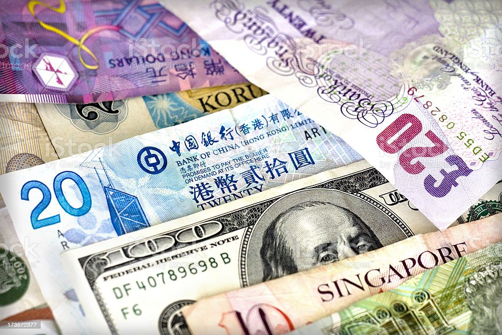 Different bills of different currencies stock photo