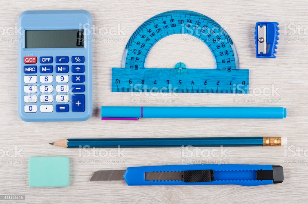 Different blue stationery tools on wooden table stock photo