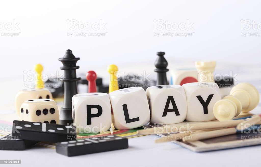 Different board game pieces in a pile stock photo