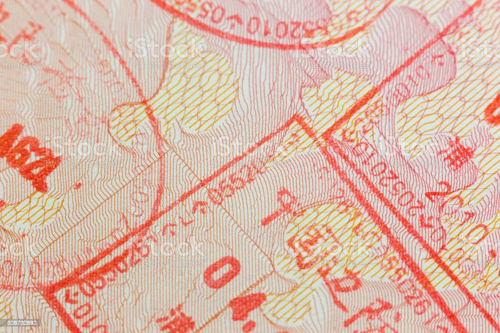 Different border stamps in a passport page - travel stock photo