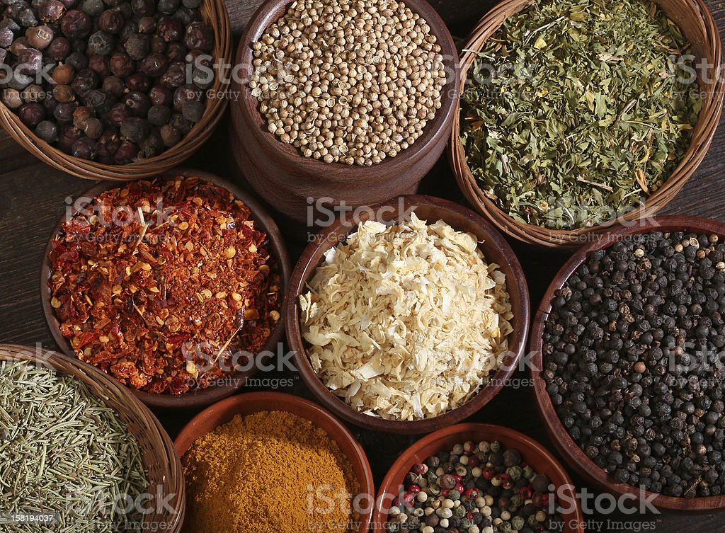 Different bowls of spices over a wooden background royalty-free stock photo