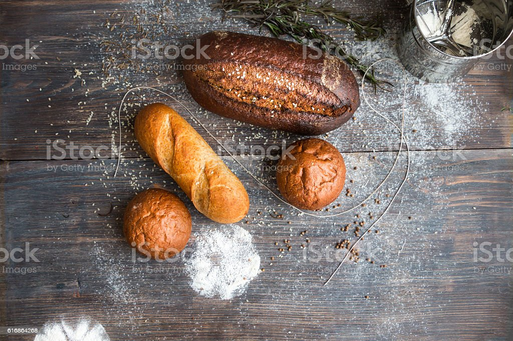 Different breads - rye, dark, roll, French baguette stock photo