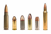 6 different bullets standing on a white background