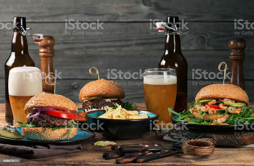 Different burgers, beer snacks with a light beer stock photo