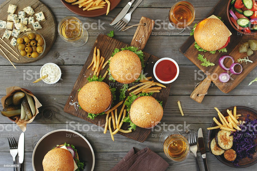 Different burgers with snacks and wine stock photo