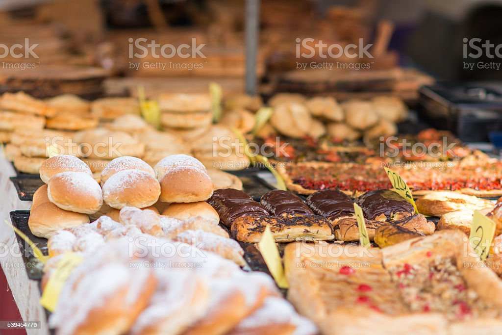 different cakes and bread on a market stall stock photo