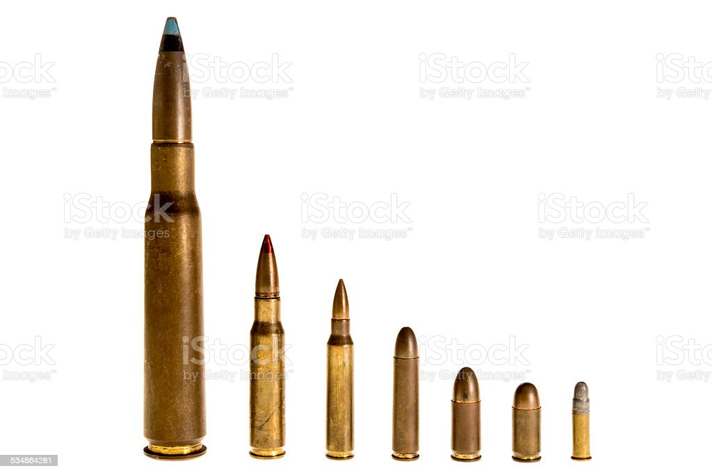 Different caliber bullets, on a white background stock photo