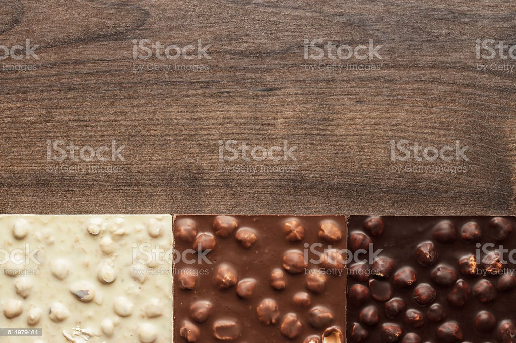 different chocolate bars with whole hazelnuts stock photo
