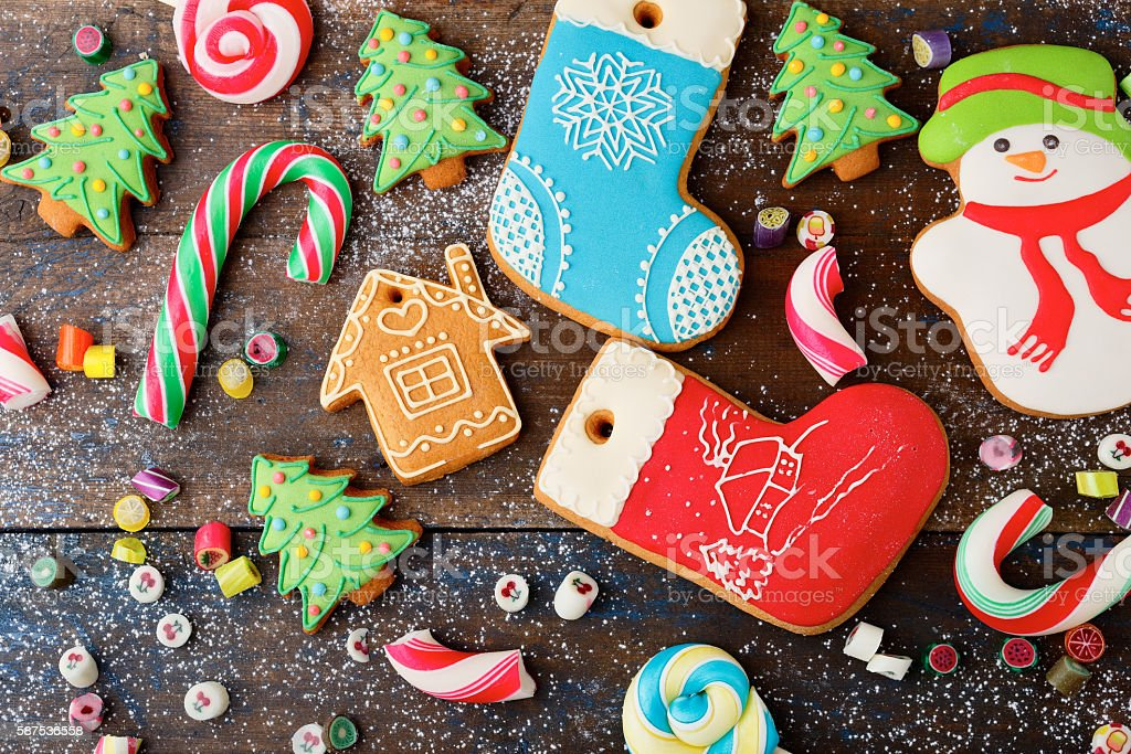 Different Christmas Gingerbread cookies and mixed candy stock photo