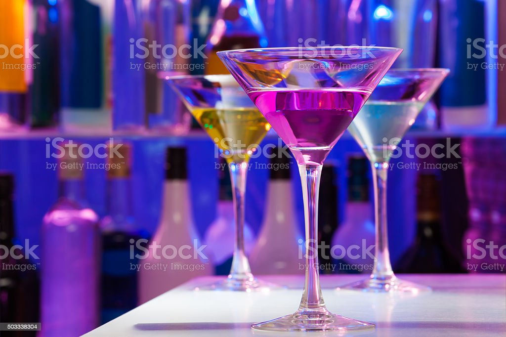 Different cocktail glasses in the bar stock photo