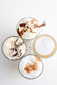 different coffee types on white background