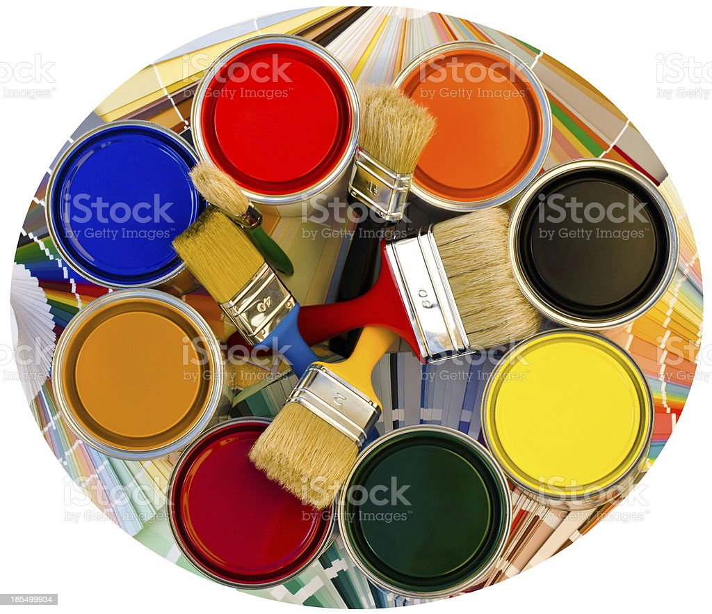 Different color cans of paint and brushes on swatches background. royalty-free stock photo