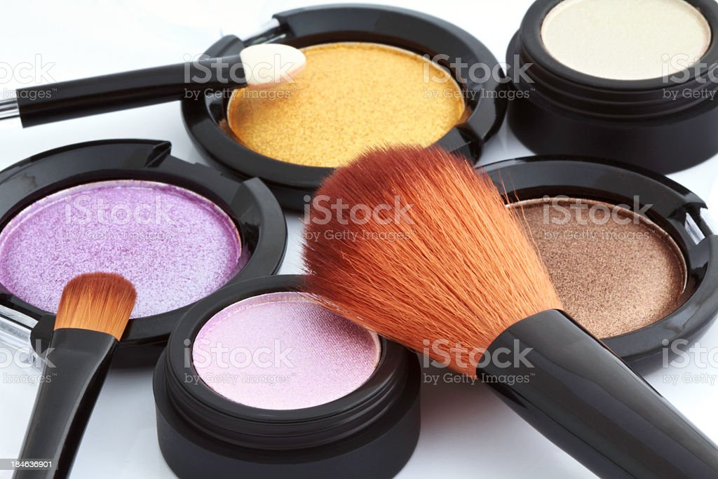 Different color cosmetic powders on white background stock photo