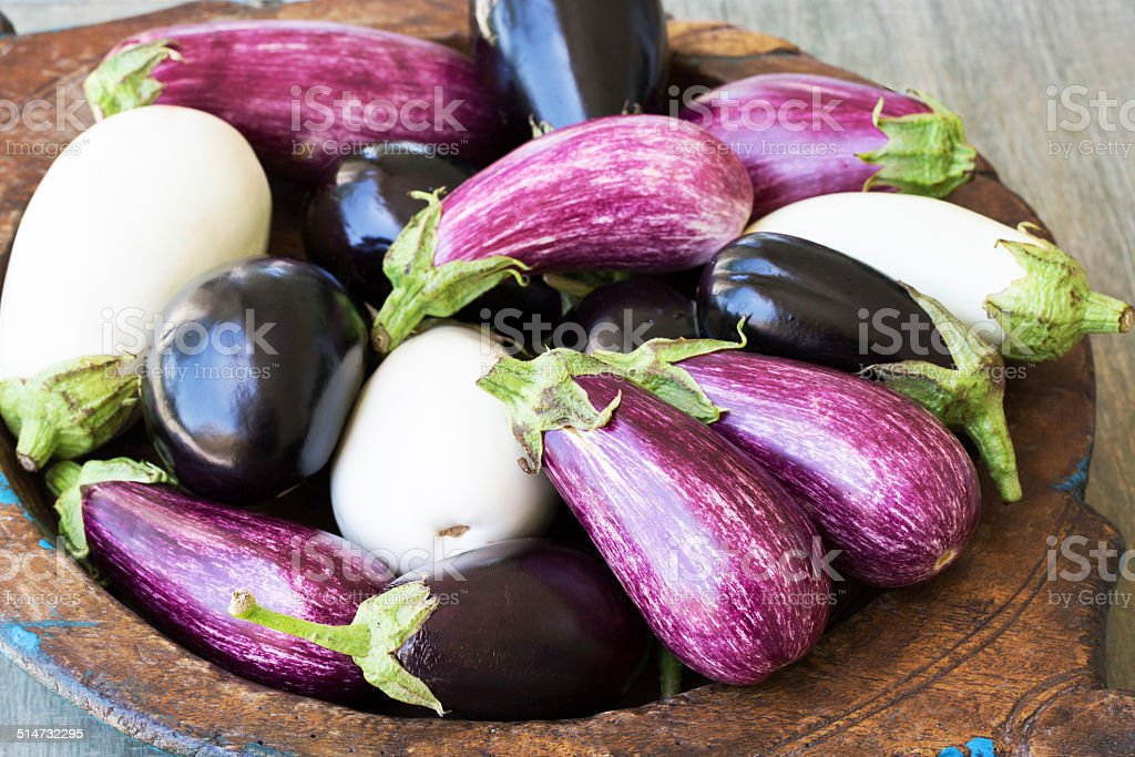 Different color eggplants stock photo