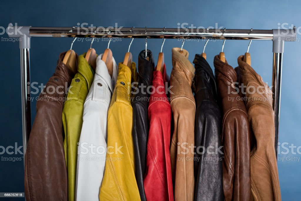 Different color leather jacket hanging on rack stock photo