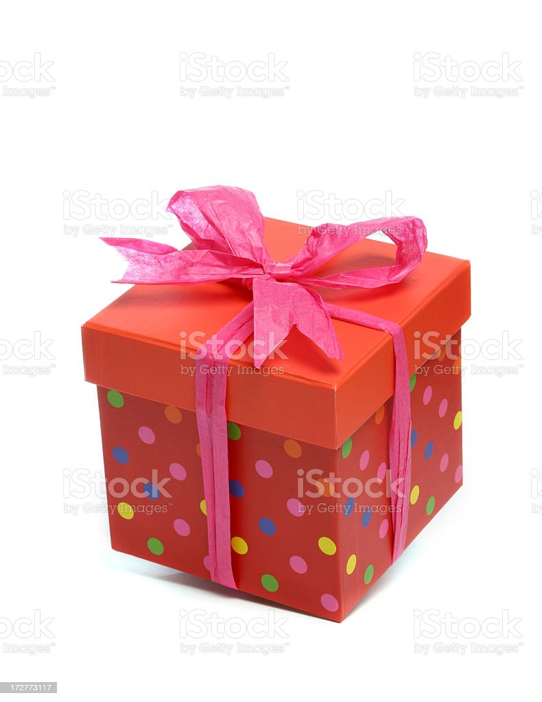 Different color polka dot gift box with pink ribbon bow royalty-free stock photo