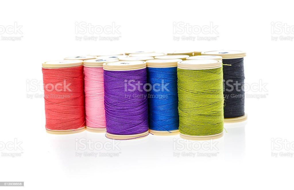 Different color Sewing Threads on a roll. stock photo
