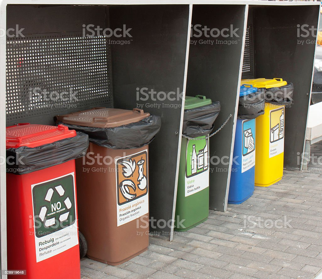 Different Colored Bins For Collection Of Recycle Materials stock photo
