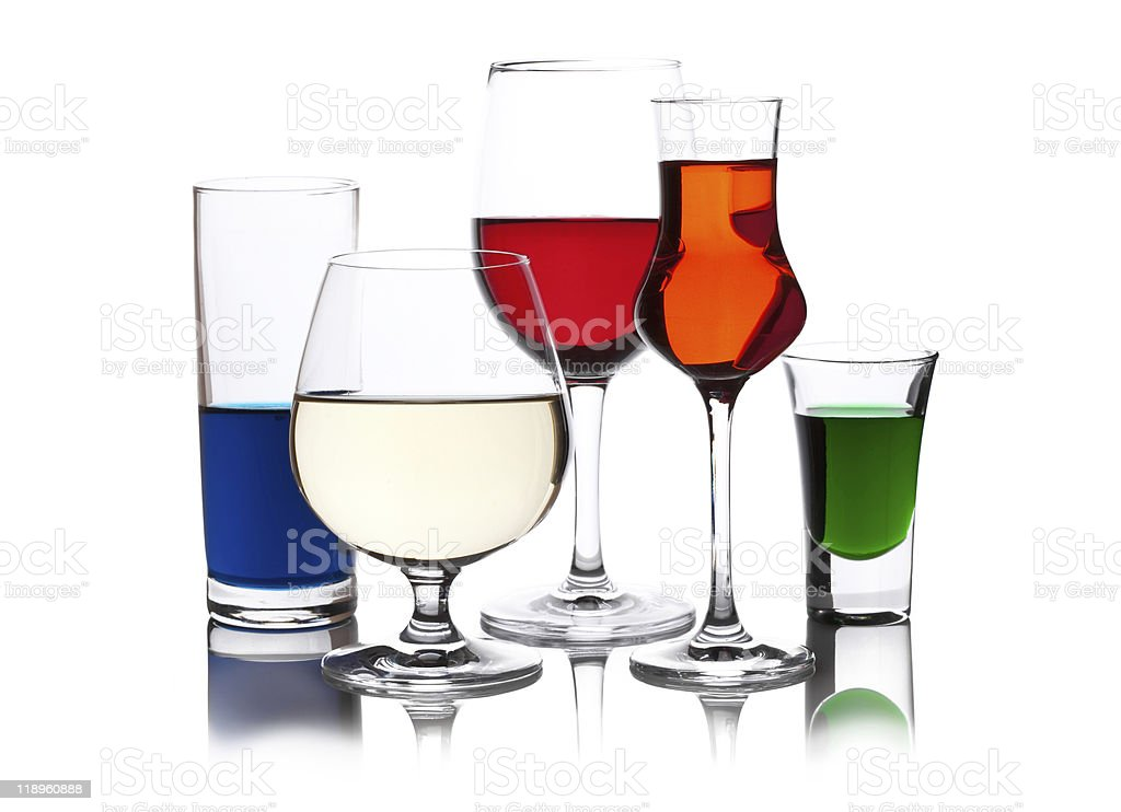 different colored drinks in wineglasses royalty-free stock photo