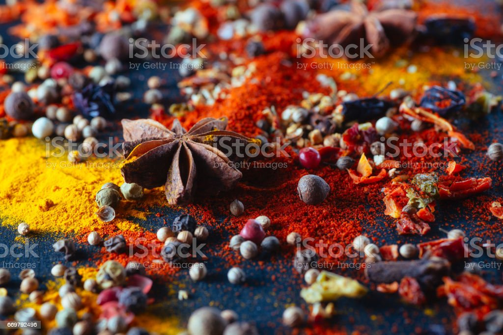 Different colorful seasonings close-up chalk board stock photo