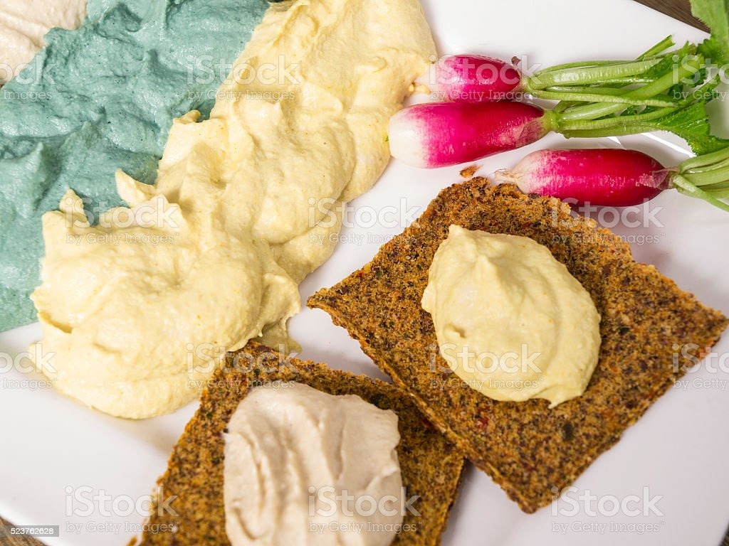 Different colors of Raw food cheese cream with raw crackers stock photo
