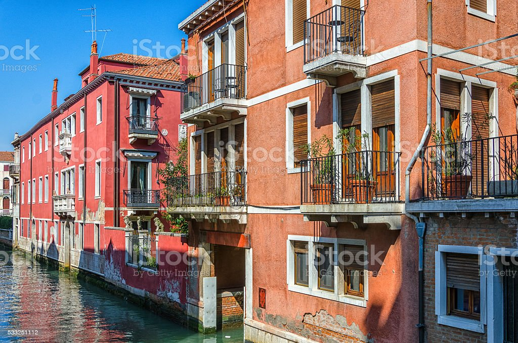 Different colours of houses on the water street in Venice stock photo
