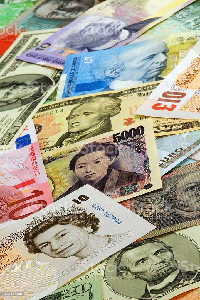 Different currencies organized as a background royalty-free stock photo