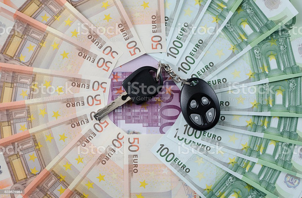 Different euro banknotes and car key stock photo