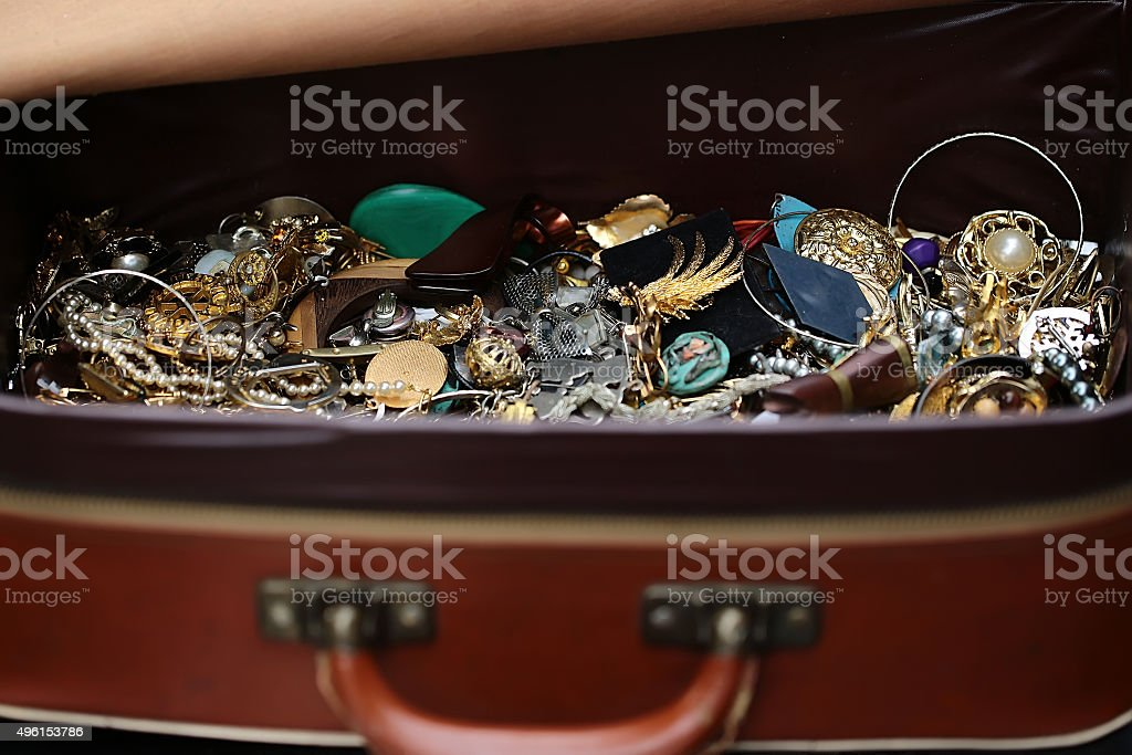 Different fashion bijouterie in suitcase stock photo