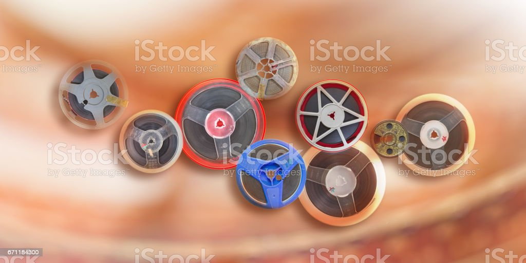 Different film spool vintage 8 mm cinema background stock photo