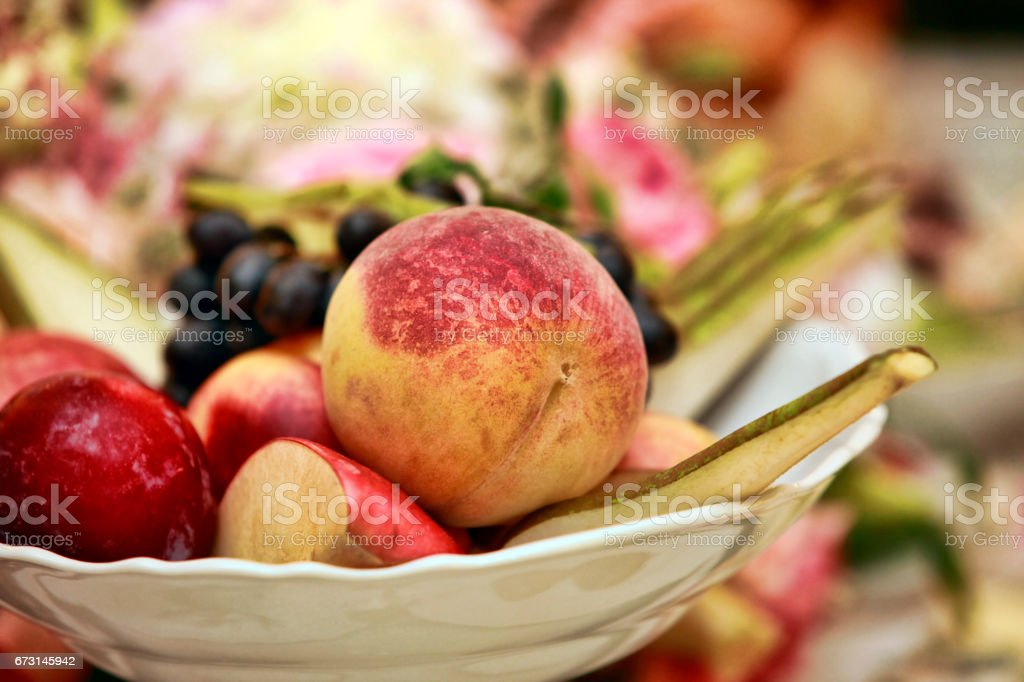 Different fresh fruits in a white plate stock photo