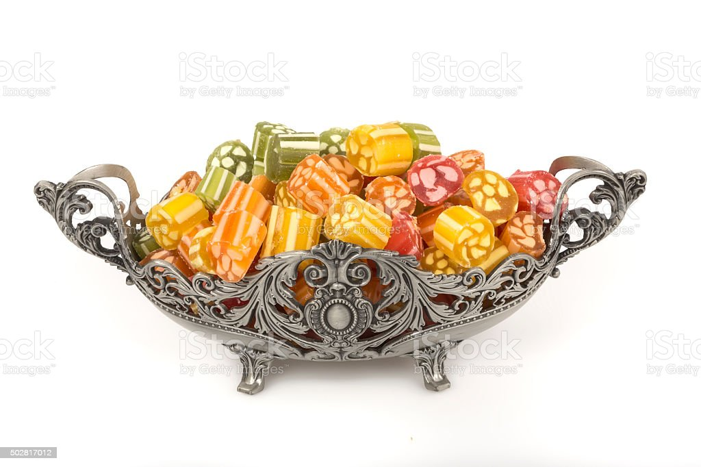 Different fruit candies on white background stock photo