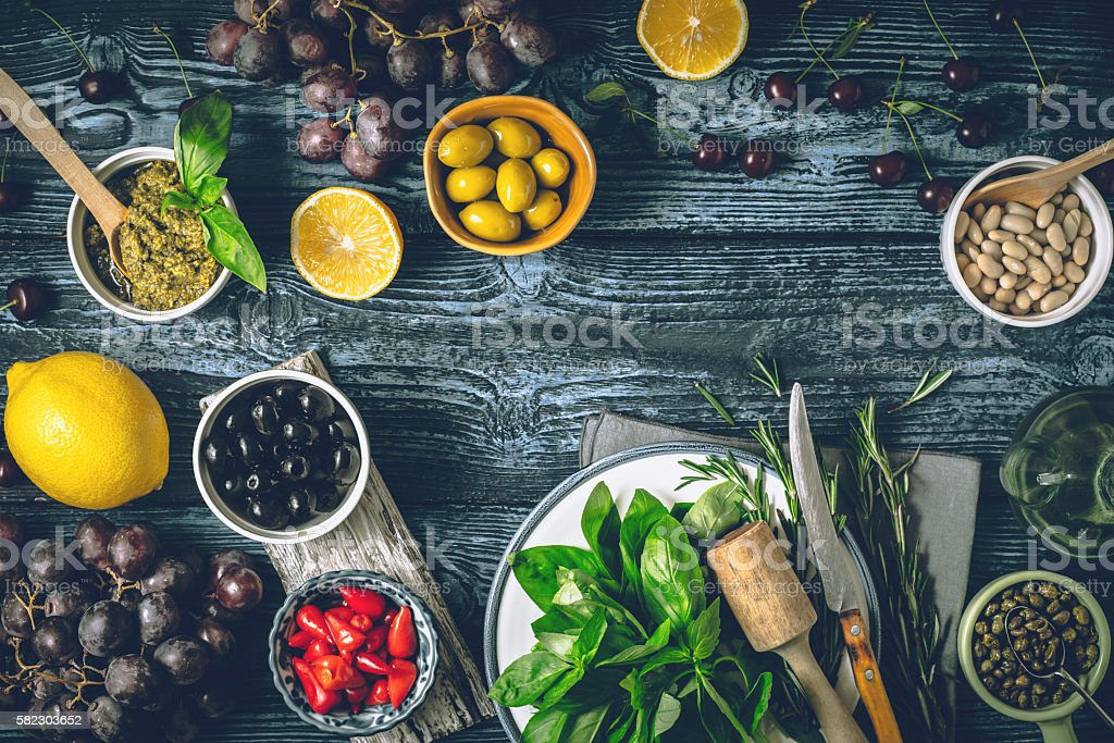 Different fruit , herbs and appetizers on the wooden table horizontal stock photo