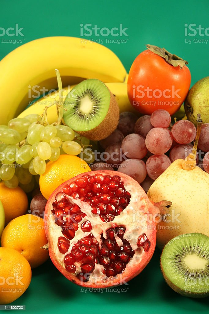Different fruit on a green background. royalty-free stock photo