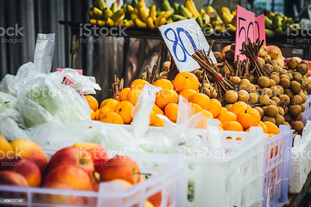 Different fruits for sale at the food market in Thailand stock photo