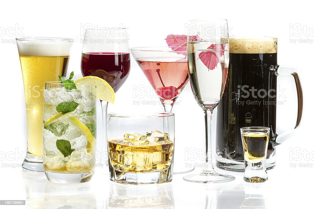 Different glasses with a variety of alcohol drinks stock photo