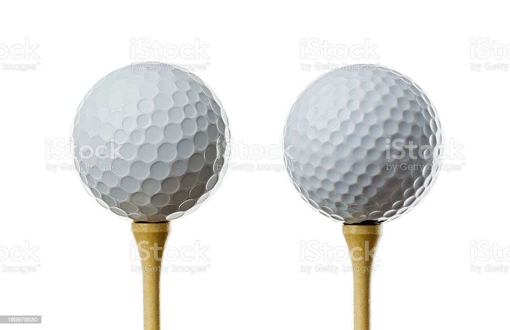 Different golf balls, on tees stock photo