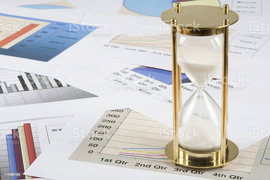 Different graphs and hourglass royalty-free stock photo