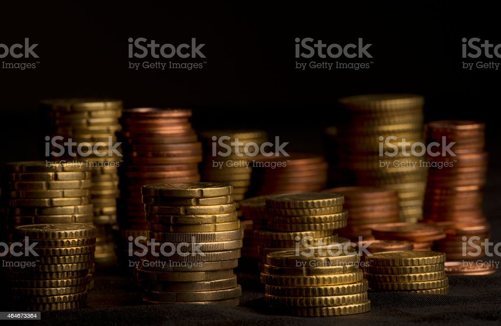 different high stacked heaps of Euro Cent coins stock photo