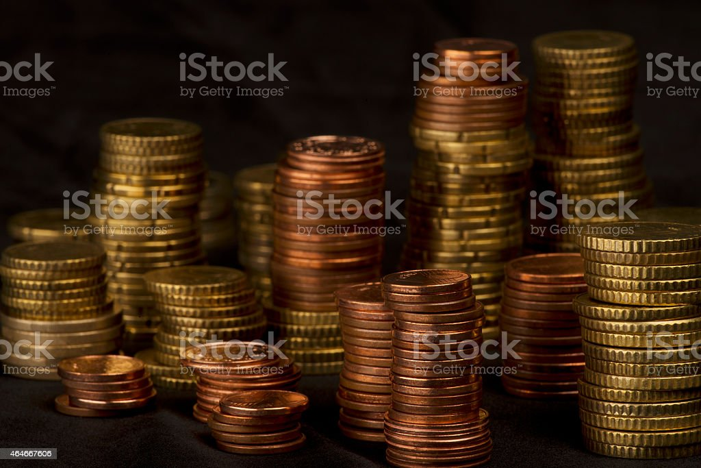 different high stacked heaps of Euro small change stock photo