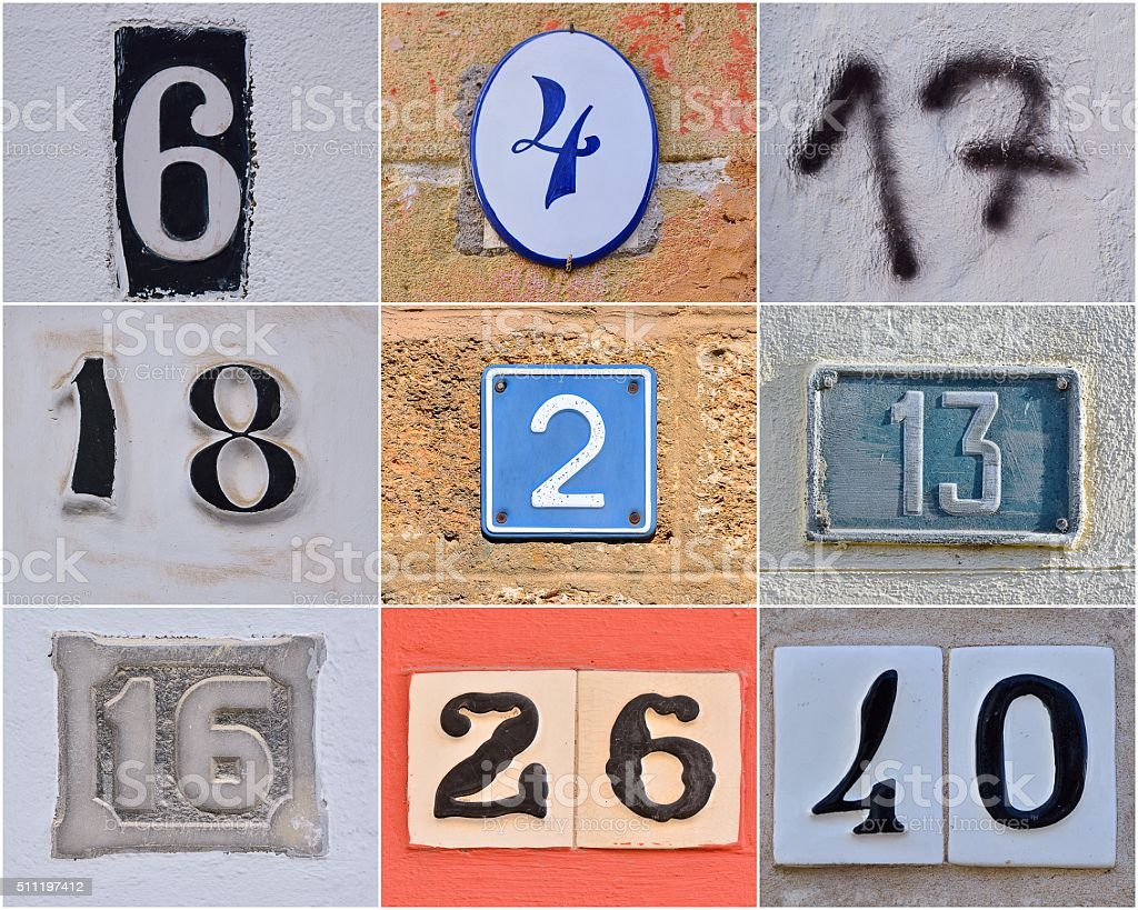 Different house numbers on walls stock photo